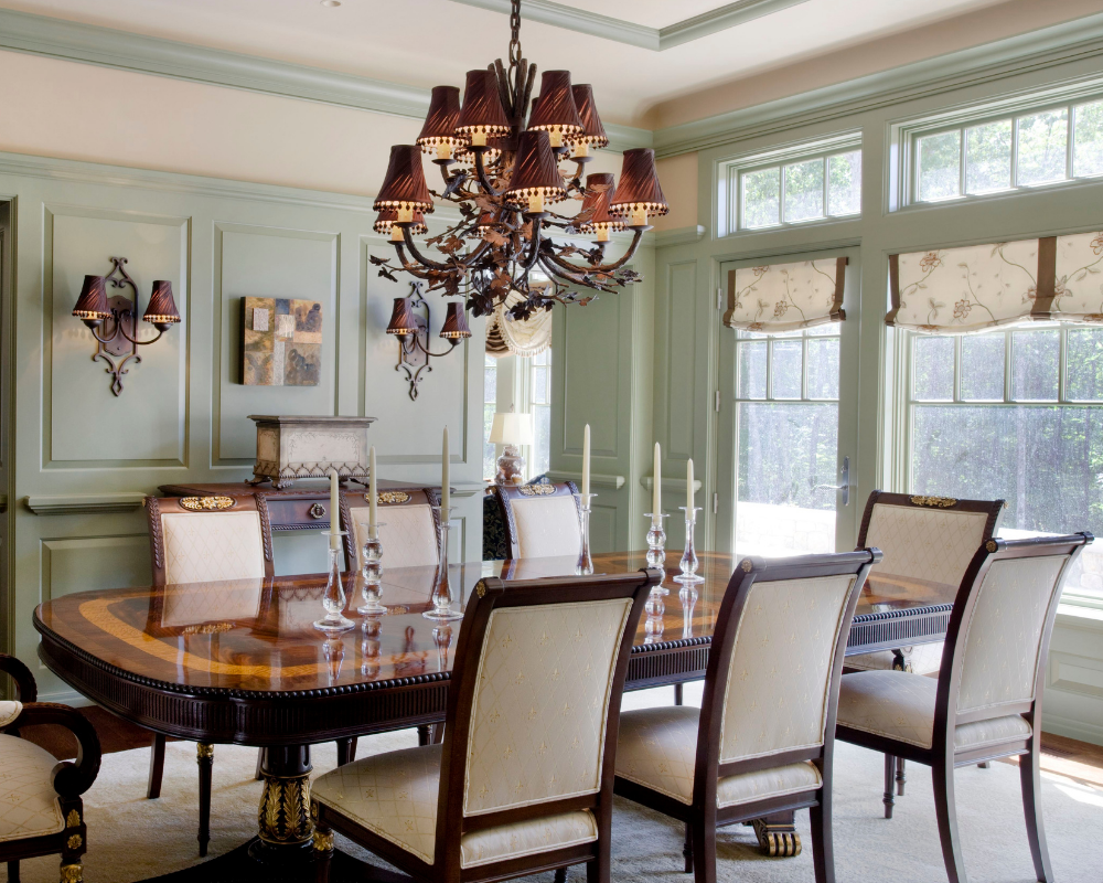 A formal organic dining room chandelier and sconces