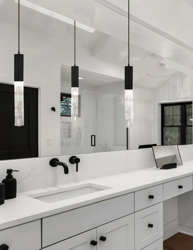 Axis pendants in a black and white modern farmhouse master bathroom.