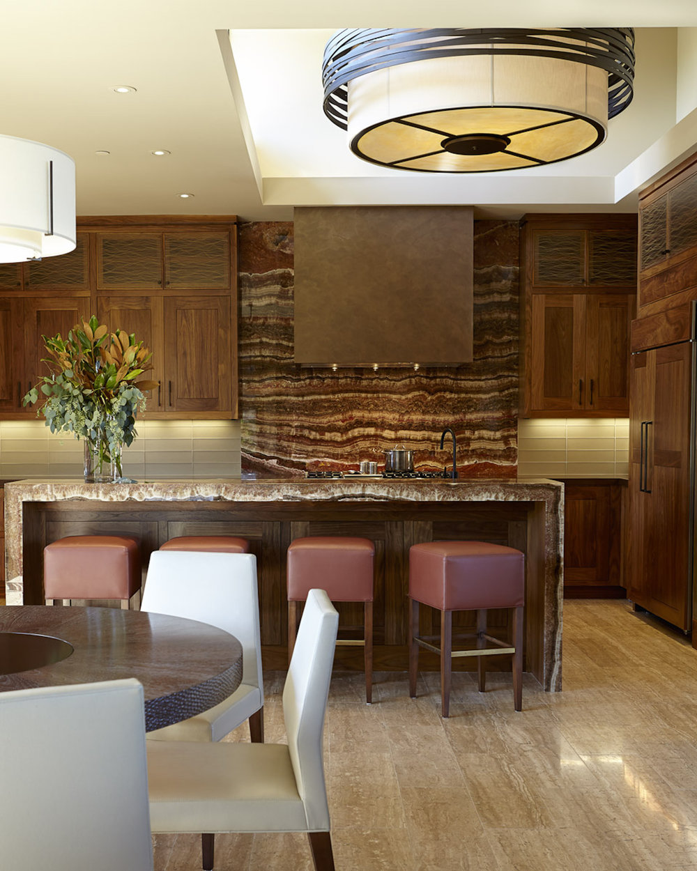 Six feet in diameter, a CHA2016 drum chandelier from the Hammerton Fusion collection makes a big design statement in this contemporary kitchen.