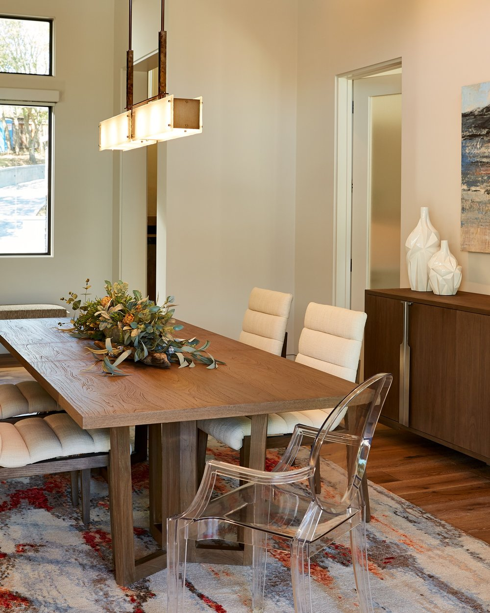 From Hammerton Studio, an Urban Loft 'Trestle' linear suspension floats above a dining table.