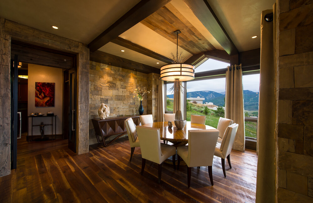 This custom drum pendant incorporates organic elements to complement a stunning Colorado view | AP Resort Concepts | Vail Colorado
