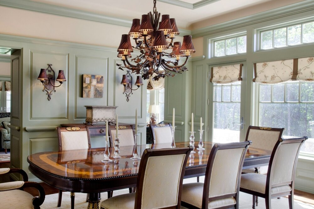 A jaw-dropping formal dining room featuring a modified Hammerton Signature CH7001 chandelier | Interiors by Randi | Moultonborough NH