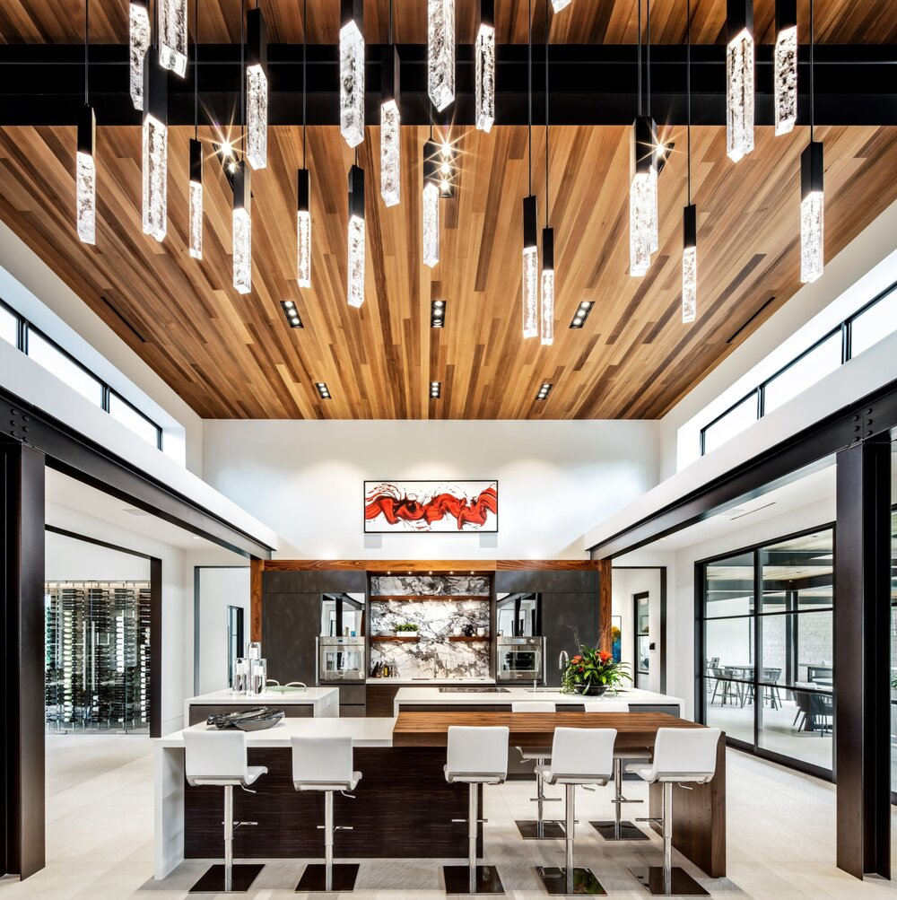 This custom Hammerton Axis multi-port chandelier gets its sparkle from recycled glass | Eklektik Interiors | Houston, TX