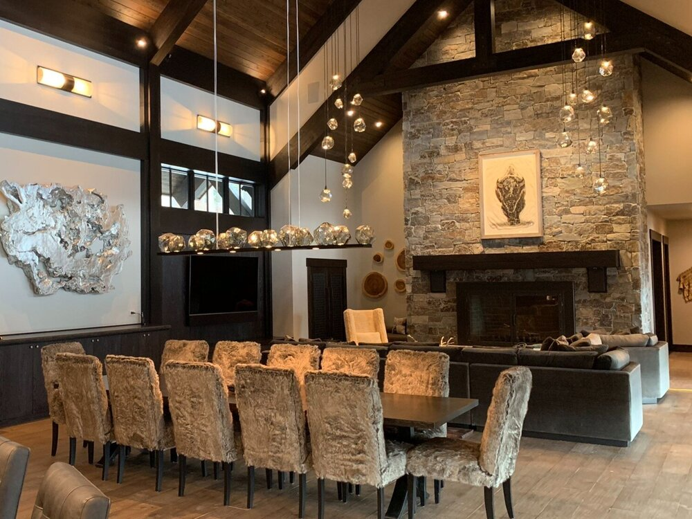 A Hammerton Studio custom Gem linear suspension ads a touch of glamour in this cozy dining space by Ronda Divers Interiors | Lake Oswego, OR