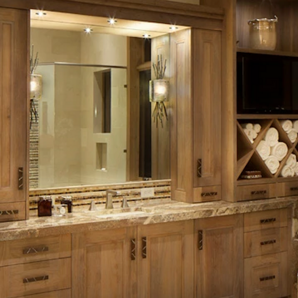 Ironwood Thistle sconces from Hammerton Studio underscore the natural materials in this spa-like design. Interiors: Fedderly and Associates l Palm Desert CA