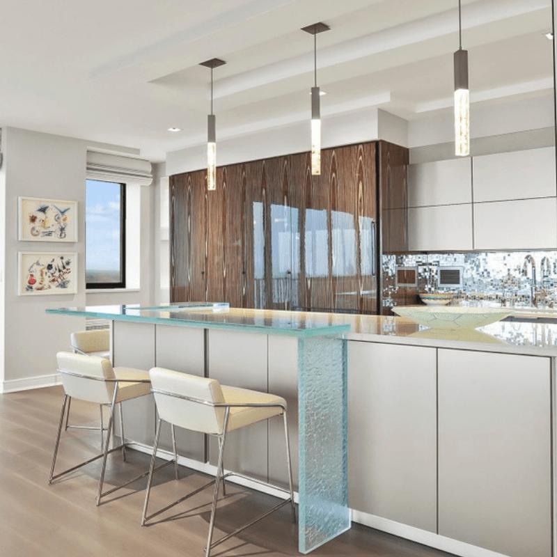 contemporary cast glass pendant lighting over kitchen island